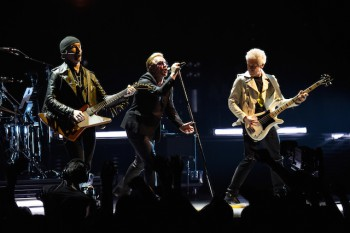 VANCOUVER, BC - MAY 14:  (L-R) Musicians, The Edge, Bono and Adam Clayton of U2 perform onstage during the U2 iNNOCENCE + eXPERIENCE tour opener in Vancouver at Rogers Arena on May 14, 2015 in Vancouver, Canada.  (Photo by Kevin Mazur/WireImage)