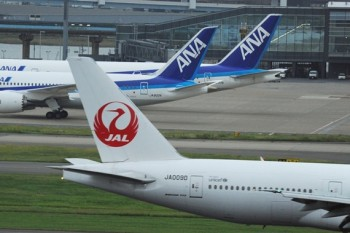 October 4th, 2013 : Tokyo, Japan - Airplanes of All Nippon Airlines, or ANA, and Japan Airlines, or JAL, were seen at Tokyo International Airport, Ota, Tokyo, Japan on October 4, 2013. The airport would increase number of airliners on international flights next year, and Ministry of Land, Infrastructure, Transport and Tourism decided two days ago decided to give ANA 11 flights and JAL five. (Photo by Koichiro Suzuki/AFLO)